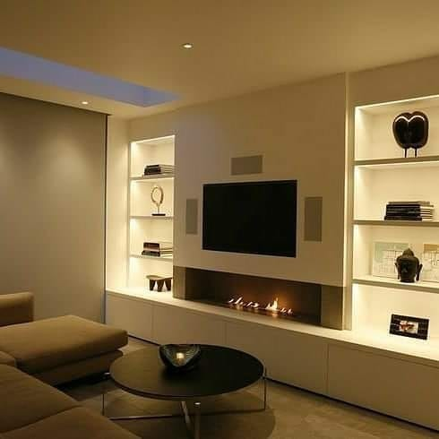 TV on wall with modern built ins via Interior Design